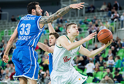 Ivan Siriscevic of Cibona vs Paolo Marinelli of KK Union Olimpija during basketball match between KK Union Olimpija Ljubljana and KK Cibona Zagreb (CRO) in 14th Round of ABA League 2014/15, on December 23, 2014 in Arena Stozice, Ljubljana, Slovenia. Photo by Vid Ponikvar / Sportida