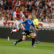 NLD/Amsterdam/20060823 - Ajax - FC Kopenhagen, Urby Emanuelson in duel met William Kvist