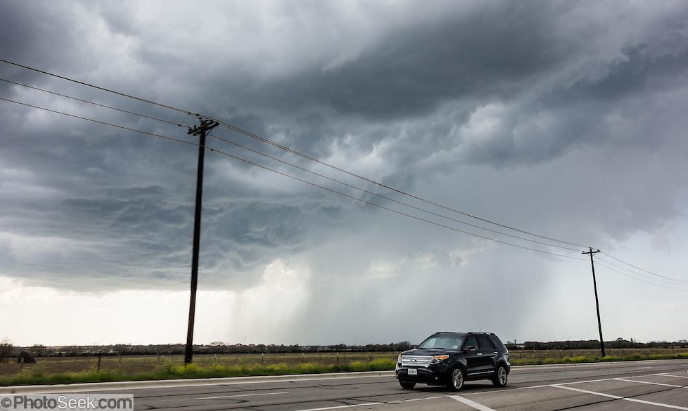 A turbulent cumulonimbus cloud drops rain near Austin, Texas, USA.