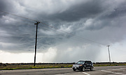 A turbulent cumulonimbus cloud drops rain near Austin, Texas, USA.