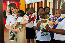 October 5, 2018 - Limuru, Kenya - First Lady Melania Trump walks with singing schoolchildren during her visit to The Nest: Children's Home in Limuru, Kenya. (Credit Image: ? Andrea Hanks/White House via ZUMA Wire/ZUMAPRESS.com)
