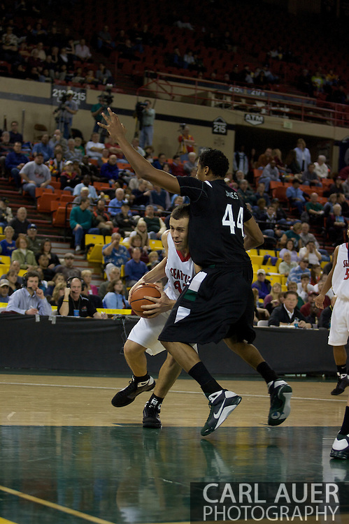 November 29th, 2008:  Anchorage, Alaska - Seattle University's Austen Powers (42) collides with Portland State's Jamie Jones (44) while attacking the hoop in the third place game on the final day of the Great Alaska Shootout.