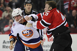 Apr 3; Newark, NJ, USA; New Jersey Devils right wing Cam Janssen (25) and New York Islanders center Micheal Haley (18) fight during the first period at the Prudential Center.