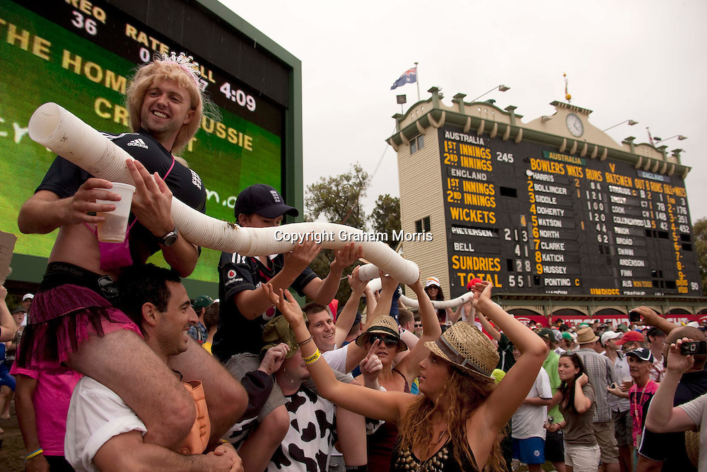 Rain starts play... a beer snake on the hill during the second Ashes Test Match between Australia and England at the Adelaide Oval. Photo: Graham Morris (Tel: +44(0)20 8969 4192 Email: sales@cricketpix.com) 5/12/10