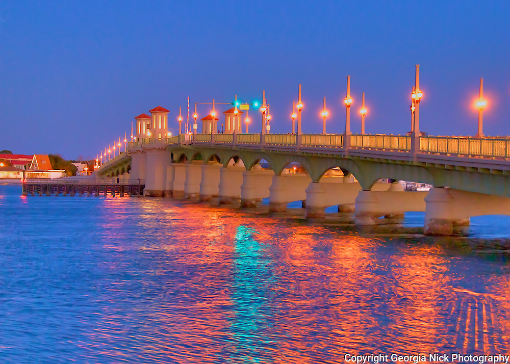 Street lights from St. Augustine, Florida's new Bridge of Lions create a colorful reflection in the water's of Matanza's Bay.