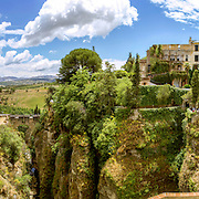 Ronda panoramic view. A city in the Spanish province of Málaga, within the autonomous community of Andalusia. Is situated in a very mountainous area about 750 m above mean sea level. The Guadalevín River runs through the city, dividing it in two and carving out the steep, 100 plus meters deep El Tajo canyon upon which the city perches