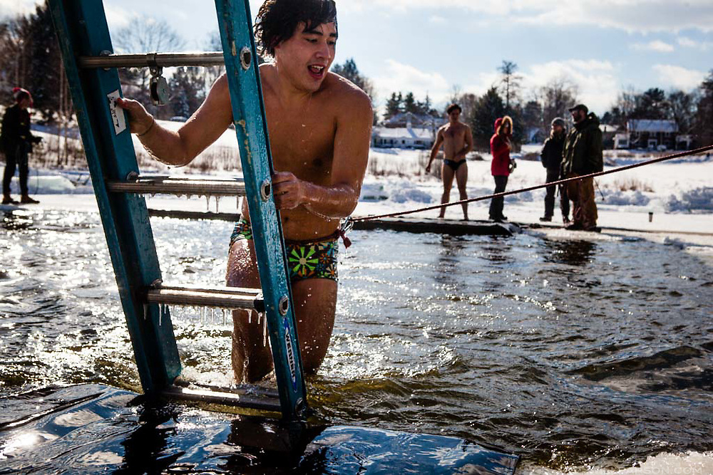 "Dartmouth College senior Ben Weill of New Haven, Conn., emerges from Occom Pond in Hanover, N.H., during the Dartmouth Winter Carnival Polar Bear Swim on February 7, 2014. Weill, who in four years at Dartmouth had never done the swim at Occom, said he and his friends were checking it off their ""bucket list."" (Valley News - Will Parson)"