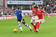 Sheffield Wednesday midfielder Ross Wallace (33) gets away from Barnsley FC midfielder Adam Hammill (7) and Barnsley Fc defender Daniel Pinillos (23) during the EFL Sky Bet Championship match between Barnsley and Sheffield Wednesday at Oakwell, Barnsley, England on 10 February 2018. Picture by Ian Lyall.