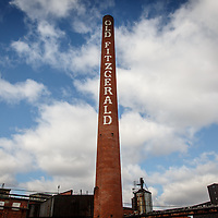 "A smokestack bearing the words ""Old Fitzgerald,"" the former flagship brand of Stitzel-Weller Distillery in the Shively area of Louisville, Kentucky, January 30, 2015. Gary He/DRAMBOX MEDIA LIBRARY"