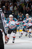 KELOWNA, CANADA - APRIL 19: Nick Merkley #10 of the Kelowna Rockets skates to the bench to celebrate a goal against the Portland Winterhawks on April 18, 2014 during Game 2 of the third round of WHL Playoffs at Prospera Place in Kelowna, British Columbia, Canada.   (Photo by Marissa Baecker/Shoot the Breeze)  *** Local Caption *** Nick Merkley;