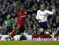 Photo. Aidan Ellis.<br />Tottenham Hotspur v Bolton Wanderers.<br />FA Barclaycard Premiership.<br />01/10/2003.<br />Spurs Stephen Carr and Bolton's Ricardo Gardener