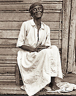 Marie sitting on her porch on the Mont Joli mountain above Cap-Haitian
