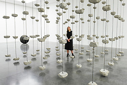 """© Licensed to London News Pictures. 11/09/2019. LONDON, UK. A staff member views """"Remains to be Seen"""", 2019. Preview of """"Remains to be Seen"""", a new exhibition by Mona Hatoum at White Cube gallery in Bermondsey.  This is the first presentation of her work since Tate Modern in 2016.  The show runs 12 September to 3 November 2019.  Photo credit: Stephen Chung/LNP"""
