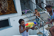 ALLENTOWN, PA – JULY 20, 2011: Dominican and Puerto Rican kids play in the street on a hot summer day in Allentown, Pennsylvania.<br /> <br /> As the population of second and third generation Hispanics increases dramatically in the United States, a new boldness can be sensed among Latinos in America, stretching far beyond the southern border states. Demographers in Pennsylvania say the towns of Bethlehem, Allentown and Reading are set to become majority-minority cities, where Hispanics comprise a bigger portion of the population than whites. As this minority population increases dramatically in the region, Latinos are inching closer to their own realization of the American Dream, while gradually shifting the physical and cultural landscapes of their communities.