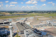 Nederland, Noord-Holland, Haarlemmermeer, 01-08-2016; Verkeerstoren en terminal gebouw, Schiphol Amsterdam Airport. Drukte wegens vakantie en extra controles door de Marechausse in verband met terrorisme-dreiging<br /> Holiday traffic and traffic jams due to out additional patrols at Schiphol Airport carried out by military police carry out  following a terrorist threat.<br /> <br /> luchtfoto (toeslag op standard tarieven);<br /> aerial photo (additional fee required);<br /> copyright foto/photo Siebe Swart