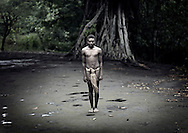 Vanuatu, Tafea Province, Tanna Island, teenager standing in the middle of the ceremonial square