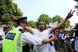 © Licensed to London News Pictures. 21/06/2017. London UK. A protest is taking place today in Westminster that is aiming to bring down the Government. The Demonstration by Movement for Justice By Any Means Necessary is billed as a day of action for the victims of the Grenfell Tower disaster. Photo credit: Andrew McCaren/LNP