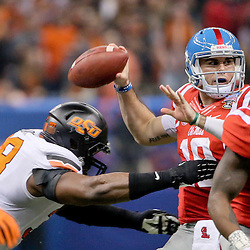Jan 1, 2016; New Orleans, LA, USA; Mississippi Rebels quarterback Chad Kelly (10) is pressured on a throw by Oklahoma State Cowboys defensive end Emmanuel Ogbah (38) during the second quarter in the 2016 Sugar Bowl at the Mercedes-Benz Superdome. Mandatory Credit: Derick E. Hingle-USA TODAY Sports