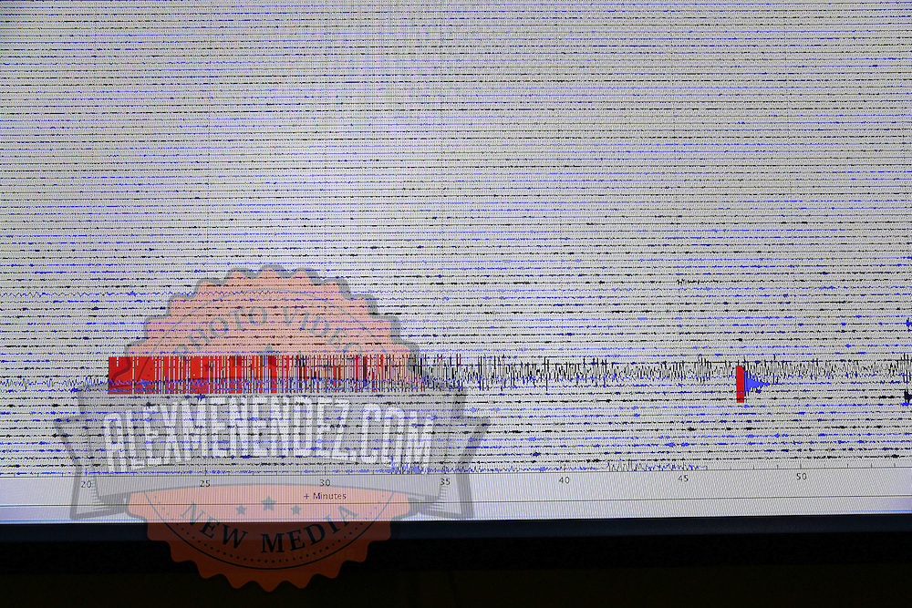 The Berkeley Seismological Lab shows in graph form, the seismogram  from the Napa earthquake as seen from a recording station located in Berkeley, California, on Sunday, August 24, 2014. A 6.1 magnitude earthquake caused significant damage and left three critically injured in California's northern Bay Area early Sunday, igniting fires, sending at least 87 people to a hospital, knocking out power to tens of thousands and sending residents running out of their homes in the darkness. Aftershocks are still being captured across the area by the data stations that are recording seismic data. (AP Photo/Alex Menendez)