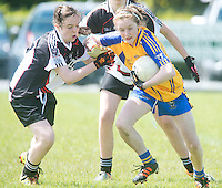 Clare's  Teresa O'Keefe breaks through despite efforts from Sligo's Leah Kelly in the All ireland U14 C championship final in Kilkerrin-Galway Photo: Andrew Downes..