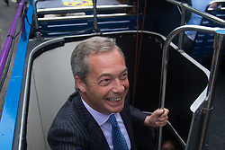 "Smith Square, Westminster, London, June 16th 2016. UKIP leader Nigel Farage launches his ""biggest ever"" advertising campaign as Leave and Remain enter their last week of campaigning before the EU referendum on June 23rd. PICTURED: Nigel Farage is all smiles as he boards the UKIP battle bus."