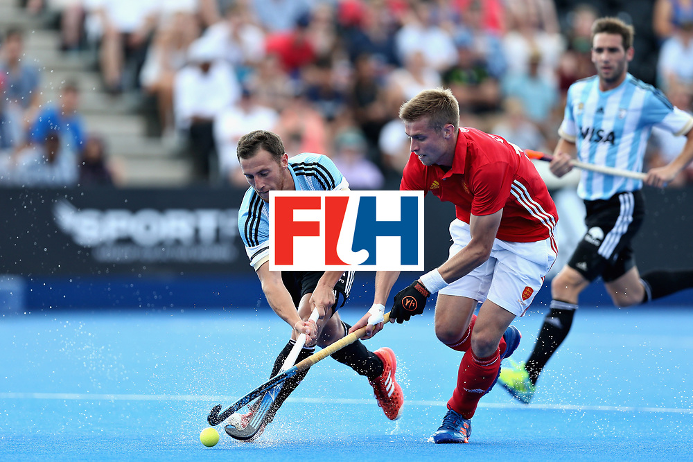 LONDON, ENGLAND - JUNE 18: Lucas Vila of Argentina tangles with Brendan Creed of England during the Hero Hockey World League Semi Final match between England and Argentina at Lee Valley Hockey and Tennis Centre on June 18, 2017 in London, England.  (Photo by Alex Morton/Getty Images)