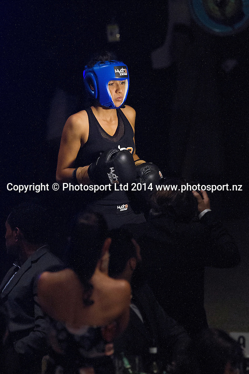 DJ Tuini enters the ring to fight  Jade Louise (The GC)  at the Hydr8 Zero Heavyweight Explosion, Vodafone Events Centre, Auckland, New Zealand, Saturday, July 05, 2014. Photo: David Rowland/Photosport