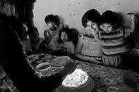 Like family, the women and children celebrate Carla Roldán's 19th birthday, with her daughter, Luisa, 2,  with cake, candles, and two birthday songs - one in English and in Spanish, at the shelter, in Quetzaltenango, Guatemala, on Saturday, May 12, 2007.