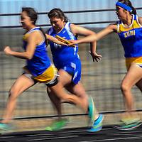 040315  Adron Gardner/Independent<br /> <br /> Zuni thunderbirds and Laguna Acoma Hawks make the baton exchange during a girls 4x100 heat at Ramah High School Friday.