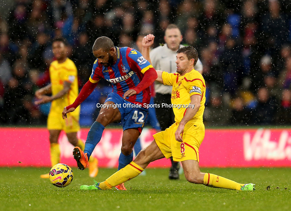 23 November 2014 - Barclays Premier League - Crystal Palace v Liverpool - Steven Gerrard of Liverpool looses the ball to Jason Puncheon of Crystal Palace - Photo: Marc Atkins / Offside.