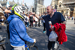 © Licensed to London News Pictures. 29/03/2019. London, UK. A Pro-Brexit campaigner argues with a passer by during a demonstration around Westminster on the day that Britain was originally due to leave the European Union. MPs today rejected Theresa May's withdrawal deal for the third time. Photo credit : Tom Nicholson/LNP
