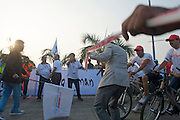 Officials struggle to contain the crowd and media frenzy as one of India's most famous movie stars (Salman Khan--the Sly Stalone of India) prepares to ride an honorary lap around the 2010 Tour of Mumbai UCI circuit  - India