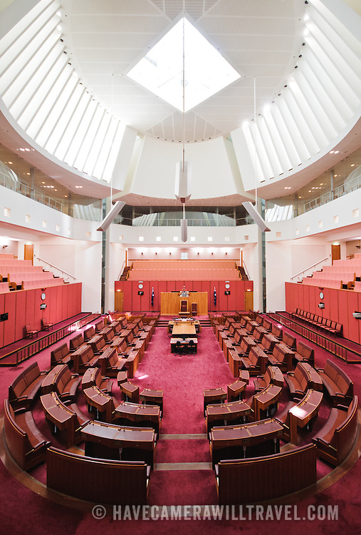 "The Senate building follows the colour scheme of the House of Lords, decorated in red, this time muted to tints of ochre, suggesting the earth and the colours of the outback. Parliament House is the meeting place of the Parliament of Australia. It is located in Canberra, the capital of Australia. It was opened on 9 May 1988 by Queen Elizabeth II, Queen of Australia.[1] Its construction cost was over $1.1 billion. At the time of its construction it was the most expensive building in the Southern Hemisphere. Prior to 1988, the Parliament of Australia met in the Provisional Parliament House, which is now known as ""Old Parliament House""."