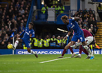 Football - 2019 / 2020 Premier League - Chelsea vs. Burnley<br /> <br /> Tammy Abraham (Chelsea FC) watches as Callum Hudson-Odoi (Chelsea FC) stabs home his teams third goal at Stamford Bridge <br /> <br /> COLORSPORT/DANIEL BEARHAM