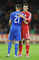 Wales Gareth Bale embraces Bosnia's Anel Hadzic - Photo mandatory by-line: Alex James/JMP - Mobile: 07966 386802 - 10/10/2014 - SPORT - Football - Cardiff - Cardiff City Stadium - Wales v Bosnia and Herzegovina - EURO 2016 Qualifiers