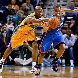 December 10, 2010; New Orleans, LA, USA; New Orleans Hornets point guard Jarrett Jack (2) and Oklahoma City Thunder guard Russell Westbrook (0) chase a loose ball during the first half at the New Orleans Arena.  Mandatory Credit: Derick E. Hingle-US PRESSWIRE