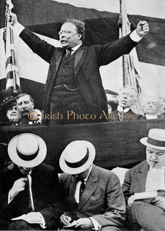 Theodore Roosevelt (1858-1919) President of USA 1901-1912 making a speech. In foreground, reporters are making notes.