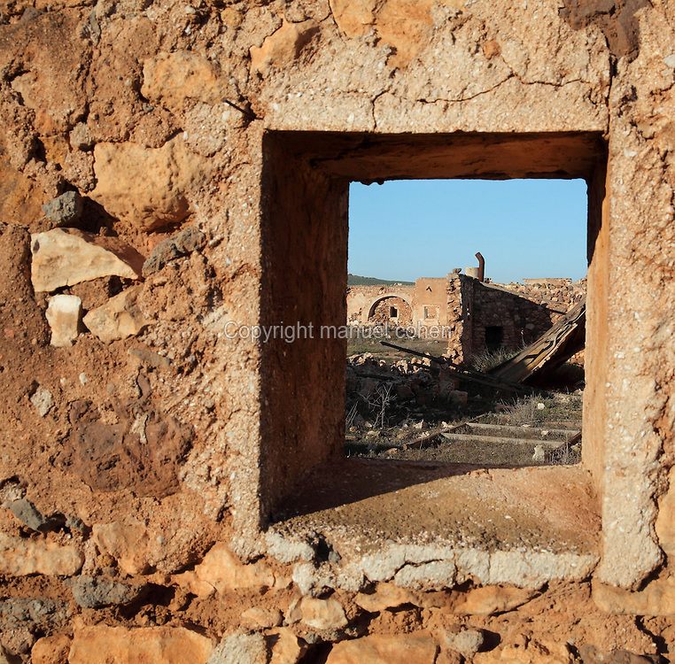 Part of the Cortijo del Fraile, farmhouse and chapel built by Dominican monks in the 18th century, now abandoned, seen through a window, in the Cabo de Gata-Nijar Natural Park, Almeria, Andalusia, Southern Spain. This is the scene of the notorious 'Crime of Nijar', when a man was shot dead in the chapel to prevent him eloping with a bride promised to the gunman's brother. The park includes the Sierra del Cabo de Gata mountain range, volcanic rock landscapes, islands, coastline and coral reefs and has the only warm desert climate in Europe. The park was listed as a UNESCO Biosphere Reserve in 1997 and a Specially Protected Area of Mediterranean Importance in 2001. Picture by Manuel Cohen