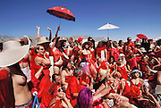After playing red rover? in red lingerie, celebrants at Burning Man assemble for a group photo. Burning Man is a performance art festival known for art, drugs and sex. It takes place annually in the Black Rock Desert near Gerlach, Nevada, USA.