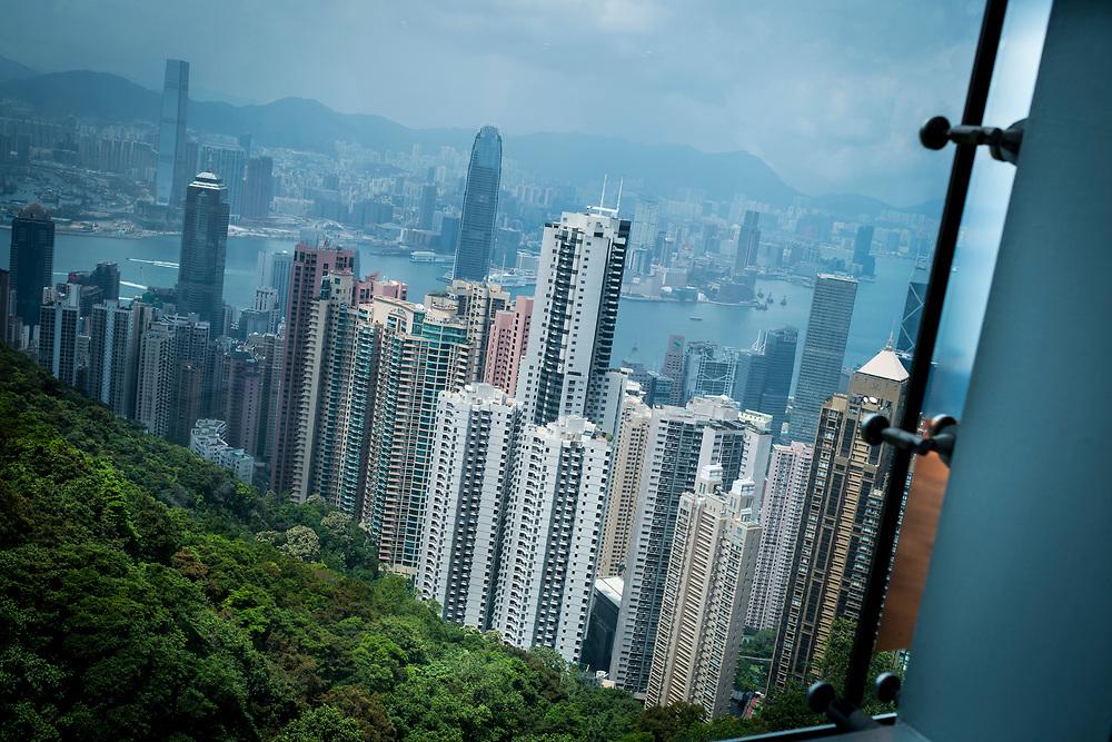 """China, Hong Kong<br /> A view from the Sky Terrace on top of Victoria Peak.  the 'concrete jungle' that constitutes the entanglement of buildings on May 01, 2018 in Hong-Kong, China. The former British territory is the city with the most skyscrapers in the world.Chine, Hong Kong<br /> Une vue de la Sky Terrace au sommet du Victoria Peak, la """" jungle de béton """" qui constitue l'enchevêtrement des bâtiments le 1er mai 2018 à Hong-Kong, en Chine. L'ancien territoire britannique est la ville qui compte le plus grand nombre de gratte-ciel au monde."""