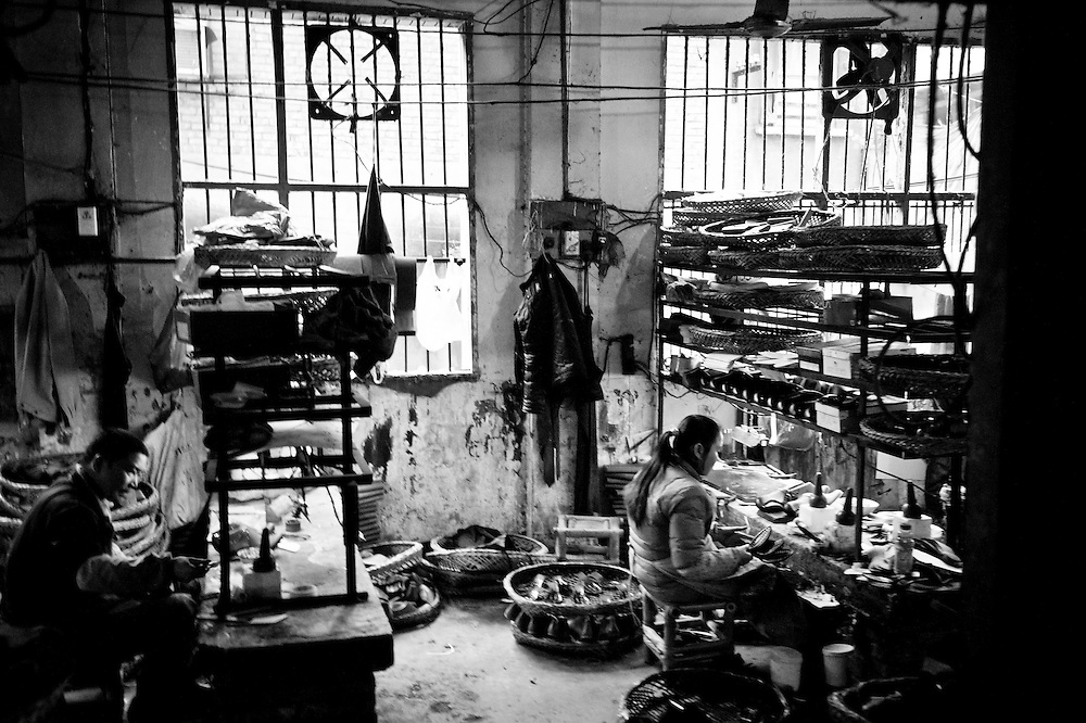 CHONGQING, CHINA - DECEMBER 31, 2010:  workers in a shoe factory