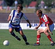 20.06.2000, Pori, Finland. .Veikkausliiga / Finnish National Championship, FC Jazz v HJK Helsinki.Aleksei Eremenko (HJK) v Ville Lehtinen (Jazz).©JUHA TAMMINEN