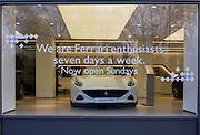 Ferrari supercar on display in a branch of luxury car dealership H.R.Owen in central London.