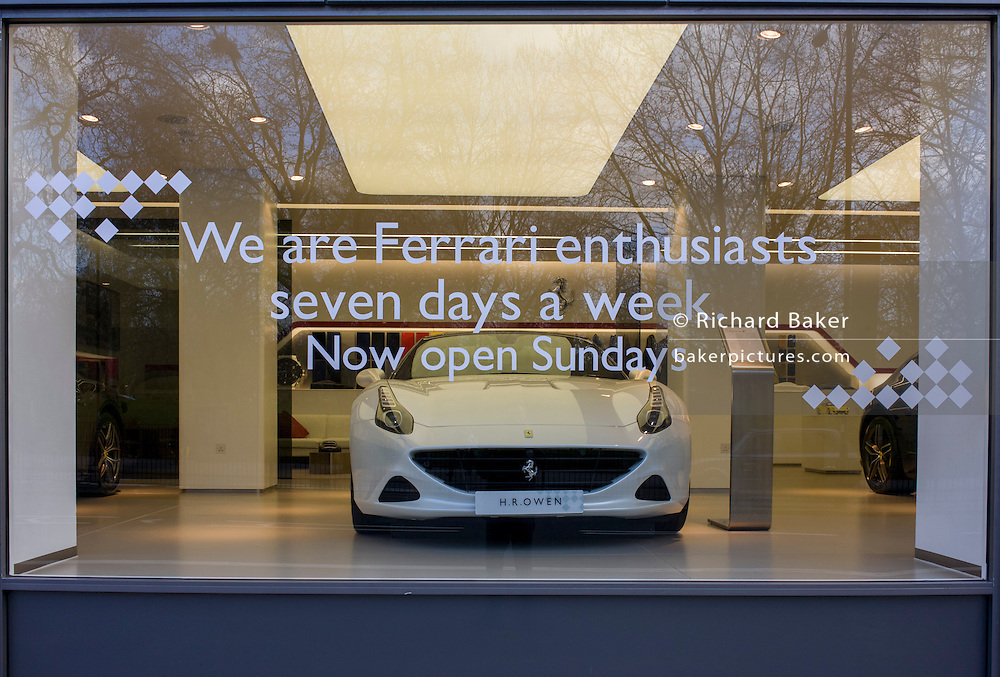 Ferrari supercar on display in a branch of luxury car dealership H.R.Owen in central London.
