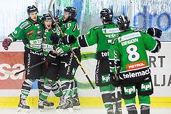 12.10.2014, Hala Tivoli, Ljubljana, SLO, EBEL, HDD Telemach Olimpija Ljubljana vs EC Red Bull Salzburg, 10. Runde, in picture Players of HDD Telemach Olimpija celebrates after scoring a goal during the Erste Bank Icehockey League 10. Round between HDD Telemach Olimpija Ljubljana and EC Red Bull Salzburg at the Hala Tivoli, Ljubljana, Slovenia on 2014/10/12. Photo by Matic Klansek Velej / Sportida