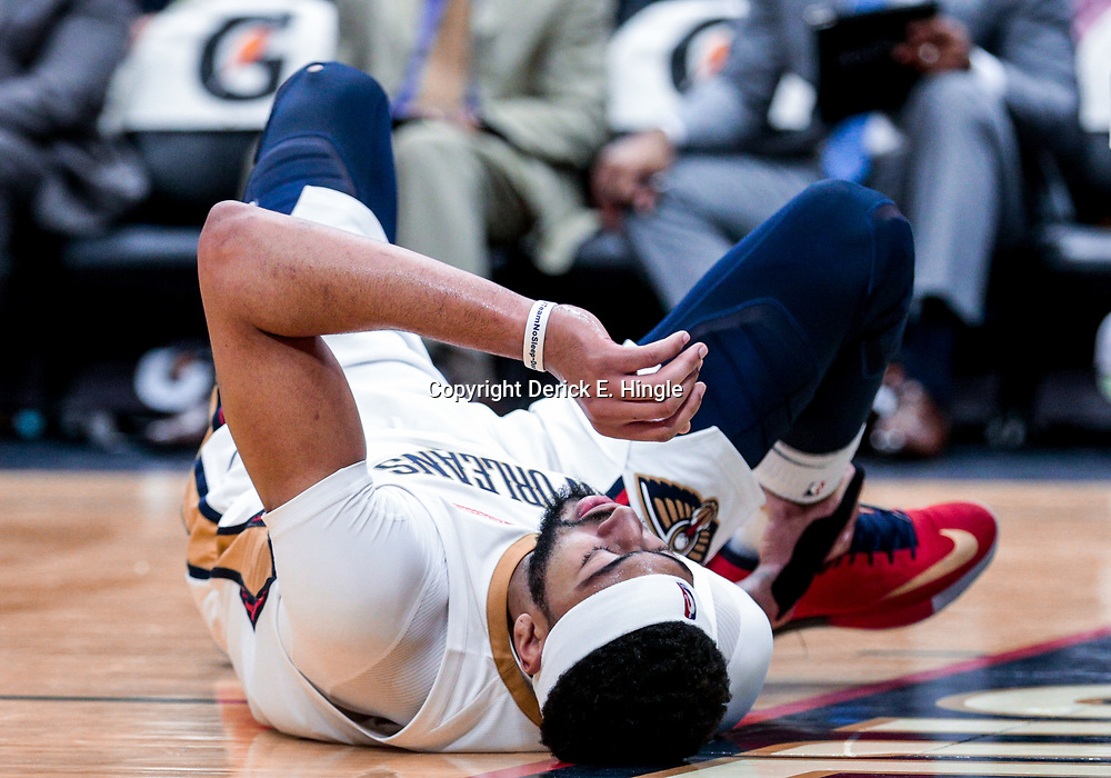 Jan 8, 2018; New Orleans, LA, USA; New Orleans Pelicans forward Anthony Davis (23) reacts after being injured during the second half against the Detroit Pistons at the Smoothie King Center. The Pelicans defeated the Pistons 112-109. Mandatory Credit: Derick E. Hingle-USA TODAY Sports
