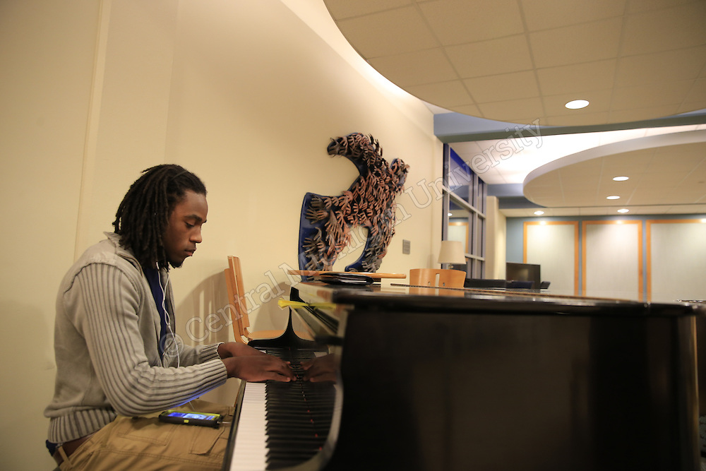 James Johnson, Flint sophomore, a mechanical engineering major, plays piano in the Fabiano/Woldt/Emmons lobby.  Photo by Steve Jessmore/Central Michigan University