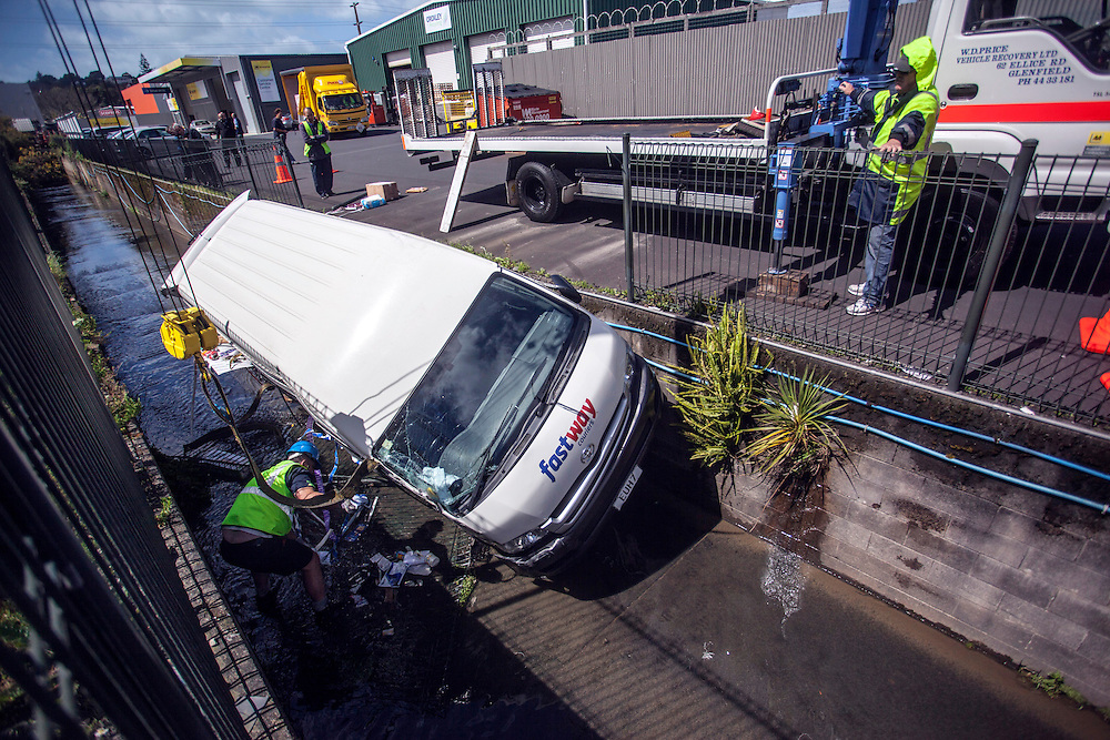 A Fastways courier van was uninjured after he drove through a barrier fence into a storm drain on Target Road, North Shore, Auckland, New Zealand, Thursday, September 26,  2013.  Credit:SNPA / Bradley Ambrose