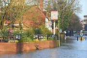 © Licensed to London News Pictures. 03/01/2014. Guildford, UK The floodwater reaches the Britannia Pub. Guilford town centre River Wey bursting it's banks in Surrey today 3rd January 2013. Floods an heavy rain are continuing to effect travel and people across the country today. Photo credit : Stephen Simpson/LNP