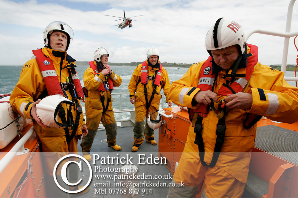 "RNLI Exercise. Yarmouth Lifeboat and helecopter ""India Juliet"" Photographs of the Isle of Wight by photographer Patrick Eden photography photograph canvas canvases"